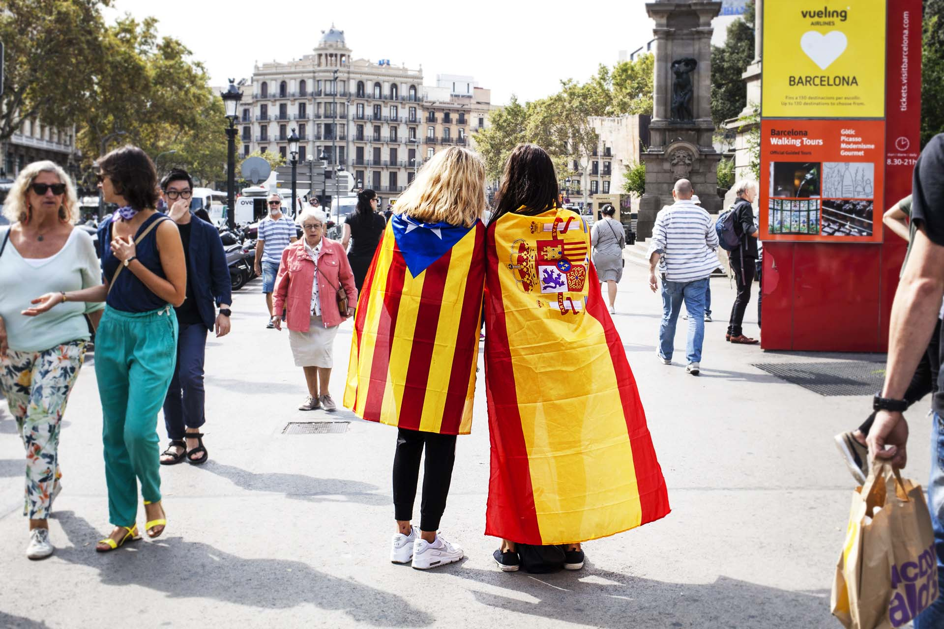 Two girls with spanish and catalan flags